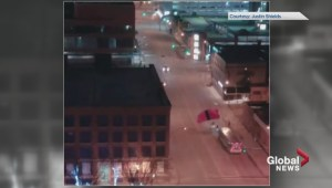 Video shows base jumpers land in downtown Edmonton