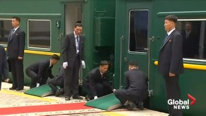 Kim Jong Un's staff struggles to line train up with red carpet