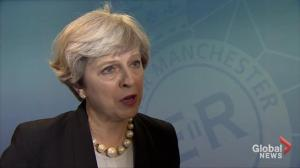 Theresa May praises 'the spirit of Manchester' following deadly explosion
