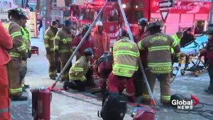 Woman rescued from maintenance hole after downtown Edmonton explosion