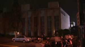 People sing songs, lay flowers and candles at Pittsburgh vigil after shooting