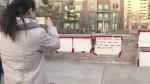 Memorial setup across street from first scene where van attack on pedestrians in Toronto