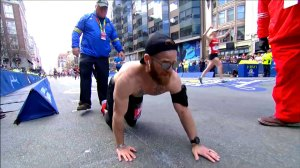 Time-lapse shows marine veteran crawl across Boston Marathon finish