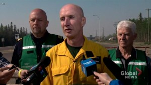 Officials say still potential risk to town as battle against High Level wildfire continues