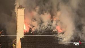 Downtown Edmonton abandoned house fire lights up morning sky