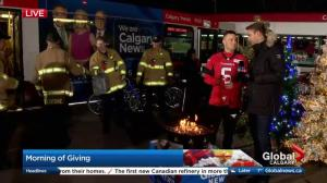 Rob Maver stops by Morning of Giving with donation from Calgary Stampeders