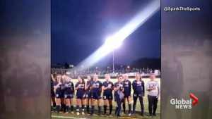 High school soccer teams sing national anthem after PA system goes out