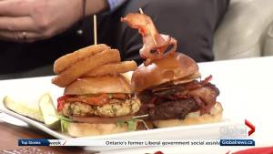 Gary Cork from The Tir Nan Og Irish pub showcases their signature burger