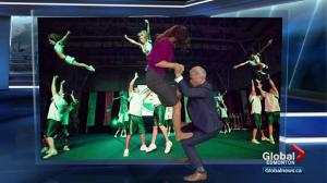 Mike and Daintre attempt a cheerleading lift