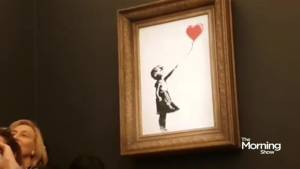 Banksy painting self-destructs (02:09)