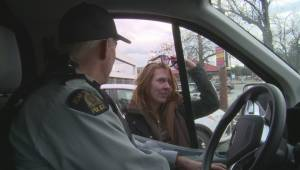 Kelowna RCMP talks to street person with drug addiction