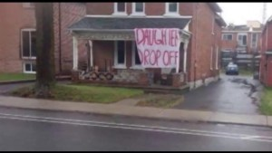 """Offensive """"Daughter Drop-off"""" sign removed from Queen's University student residence."""