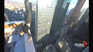 Roof topping stunt in Toronto leads to break and enter, mischief charges from police