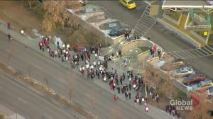 Alberta health-care support workers striking outside the Royal Alexandra Hospital Monday morning (01:57)