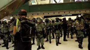 Hong Kong police search shopping mall in crackdown on protesters
