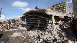 Rescue workers comb through the rubble of deadly building collapse in Kenya
