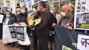 Hong Kong politicians hold memorial for coronavirus whistleblower Li Wenliang outside Chinese government office