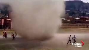 'Dust devil' interrupts local soccer game in Bolivia (00:39)