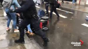 Person in wheelchair knocked over as French police charge protesters