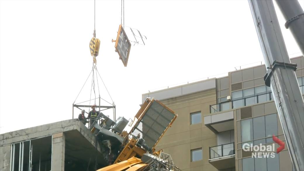 Crew begin dismantling pieces of toppled crane in Halifax