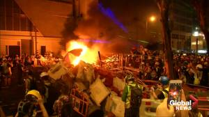 Barricade burnt as Hong Kong protest heats up