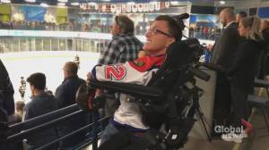 Man with cerebral palsy able to stand for national anthem at Moncton hockey game