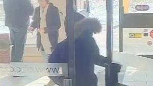 Armed robbery suspect at large