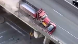 Dump truck driver charged after pushing mini cooper onto Gardiner Expressway (00:33)