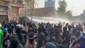Police use water cannons as Chile protests flare up