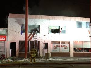 2 taken to hospital as crews battle central Edmonton fire at Italian Bakery