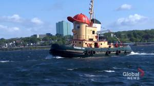 Iconic smiling tugboat sets sail for his new home (02:00)