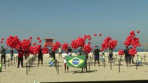 Coronavirus: Non-profit group in Brazil places crosses, release balloons to mark 100,000 deaths from COVID-19