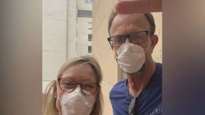National COVID-19 outbreak hits sobering milestone