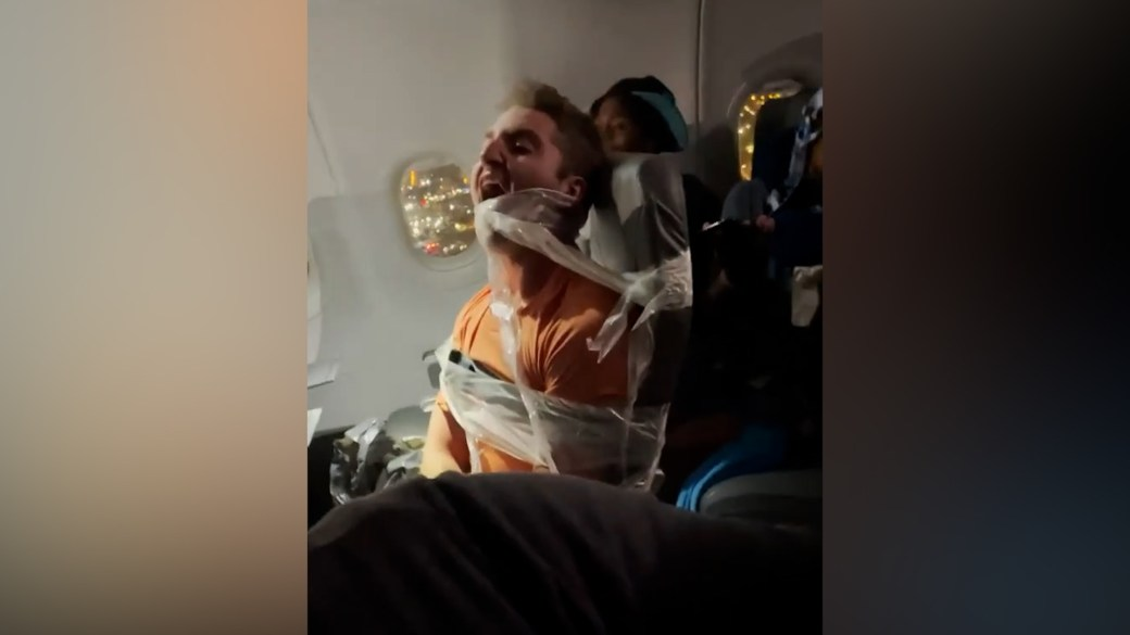 Click to play video: 'Unruly passenger duct-taped to seat after attacking flight attendants'