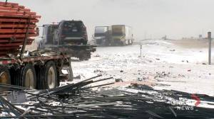 Wintry weather leads to massive pileup east of Calgary (01:44)