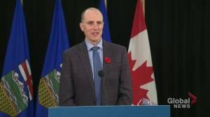 How do Alberta farmers prevent spread of swine flu between operations? (01:14)