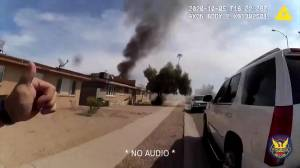 Body-cam video shows police office saving residents from burning building in Arizona (01:29)