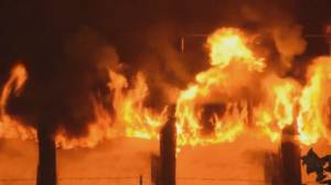 Crews say fire burning section of New Westminster's Pier Park 'could burn for days' (03:41)