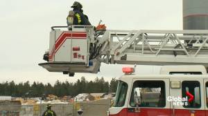 West Kelowna fire crews douse hot spots at extinguished industrial fire