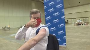 Mayor John Tory rolled up his sleeves for the flu shot calling on Torontonians to do the same (02:04)