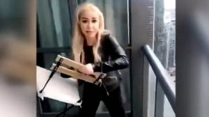 Woman accused of tossing chair off balcony pleads guilty, seeks a suspended sentence (01:40)
