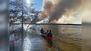 Eight canoers have trip cut short due to wildfire evacuation and luck (01:40)