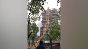 Hurricane Dorian: Crane lies on building, street after collapsing during storm