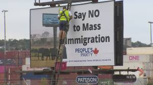Anti-immigrant billboard taken down after backlash