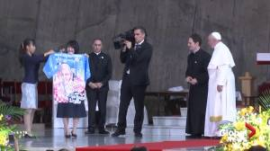 Pope Francis presented with Japanese happi with his face on it