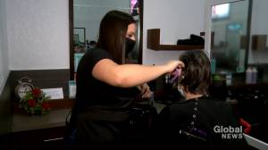 Every cut counts: hair salon's clients raise money to support military veterans (01:40)