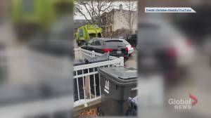 Video appears to show motorist driving down Toronto sidewalk to pass garbage truck, vehicles