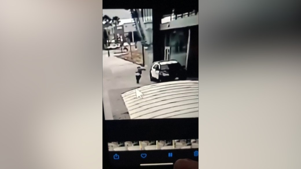 Click to play video 'Surveillance video shows moment two police officers abushed, shot in Los Angeles'
