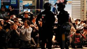 Hong Kong police arrest dozens of protesters during New Year's Day clashes
