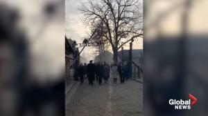 Auschwitz survivors walk through camp gates on 75th anniversary of liberation
